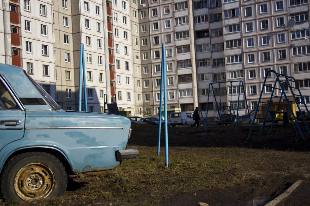 Belarus - old car infront of building