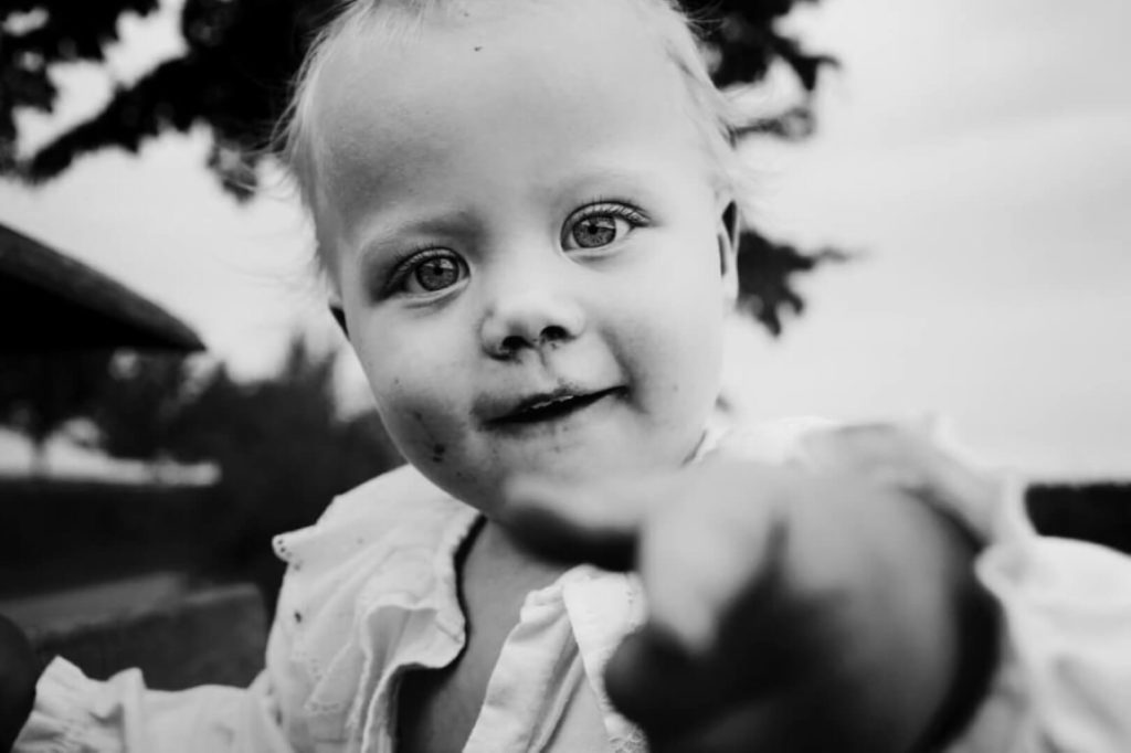 Child watching direcly into the camera